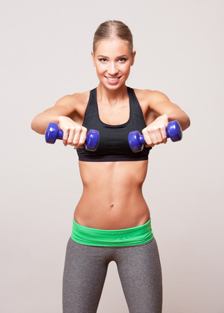 slender woman: Portrait of a gorgeous young blond fitness woman.