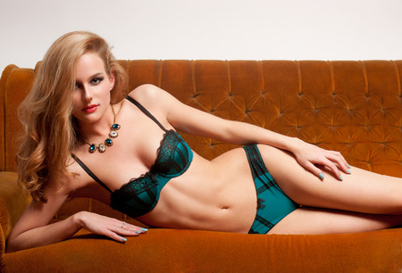 young woman panties: Portrait of a sensual slender blond lingerie beauty.