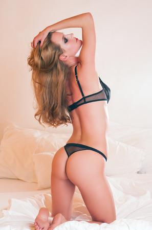 hot ass: Portrait of a sensual slender blond lingerie beauty.