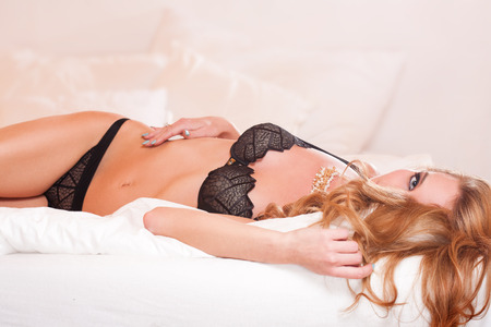 young woman panties: Portrait of a gorgeous sensual blond woman in lingerie. Stock Photo