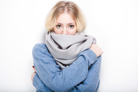 Portrait of a beautiful young blond woman in warm clothes. Stockfoto