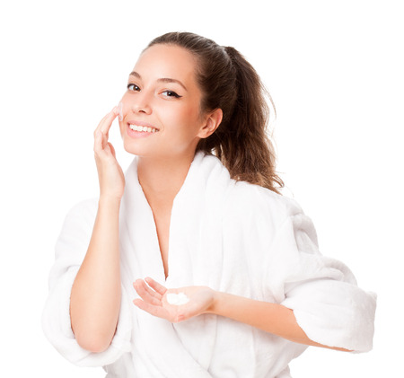 body milk: Portrait of a young happy brunette cosmetic beauty.