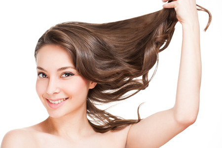 are strong: Portrait of a brunette beauty with strong healthy hair.