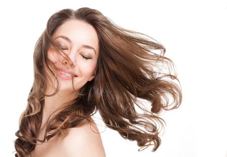strong wind: Portrait of a gorgeous young brunette woman with healthy hair.