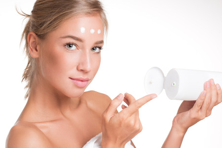 body milk: Portrait of gorgeous young blond woman using body milk. Stock Photo