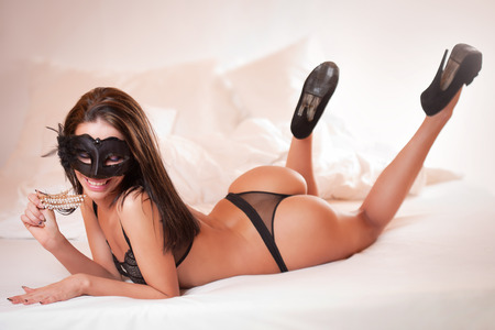 nude ass: Very sexy brunette posing in stylish black lingerie.