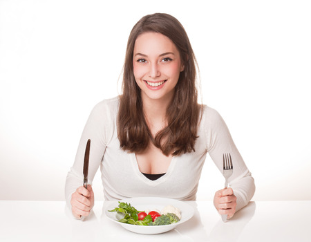 Portrait of gorgeous young brunette with diet concept.