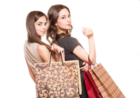 Couple of brunette beauties having shopping fun. photo