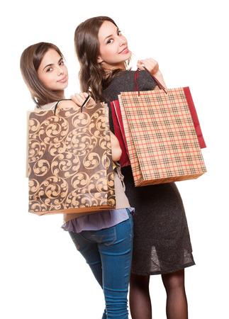 beauties: Couple of brunette beauties having shopping fun. Stock Photo