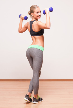 ass fun: Portrait of a gorgeous young blond fitness woman.