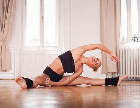 nimble: Gorgeous fit young blond woman practicing dance moves.