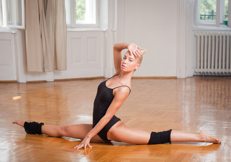 nimble: Young blond fitness beauty doing dance moves. Stock Photo