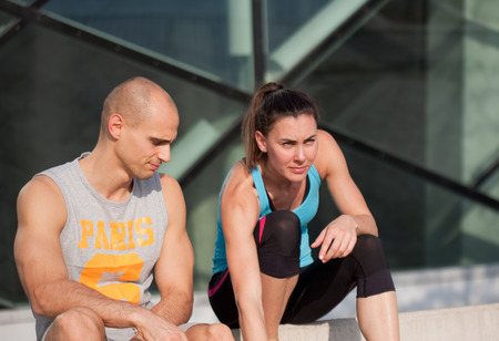 fit couple: Very fit couple having running fun outdoors.