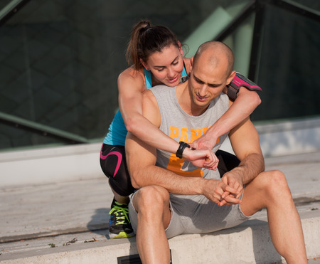 cardiovascular workout: Sporty attractive young couple outdoors.