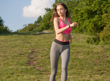 running pants: Portrait of a young beauty in nature. Stock Photo
