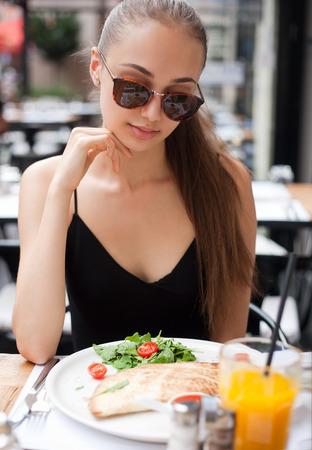 italian cuisine: Gorgeous young brunette woman having italian cuisine. Stock Photo