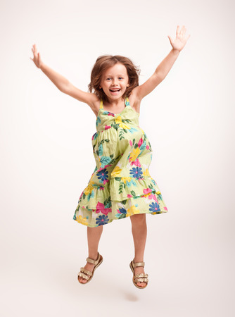 full figure: Portrait of a brunette beautiful energetic young girl. Stock Photo