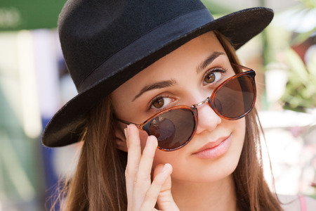 gorgeous girl: Closeup portrait of gorgeous young brunette woman wearing sunglasses.