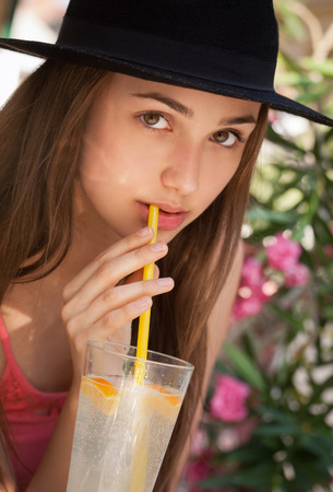 refreshments: Gorgeous young woman having summer refreshments.