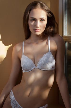 hot girl nude: Artistic portrait of sensual lingerie brunette in creative lighting. Stock Photo