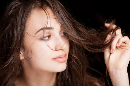 hair shampoo: Portrait of a young brunette beauty with shiny wet hair.