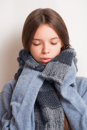 get ready: Get ready for the cold, brunette girl in large blue sweater. Stock Photo