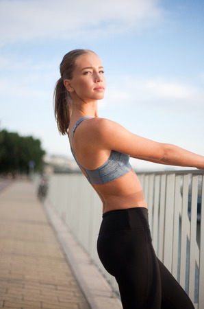 young beautiful woman: Beautiful fit young blond woman urban fitness.