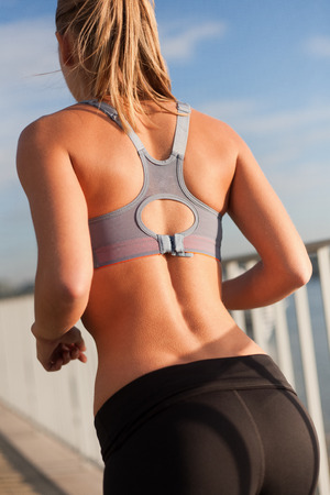running pants: Beautiful fit young blond woman urban fitness.