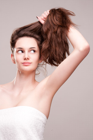 choosing: Portrait of a gorgeous young brunette woman with amazing full hair.