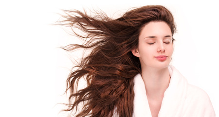 Portrait of a gorgeous young brunette woman with amazing full hair.