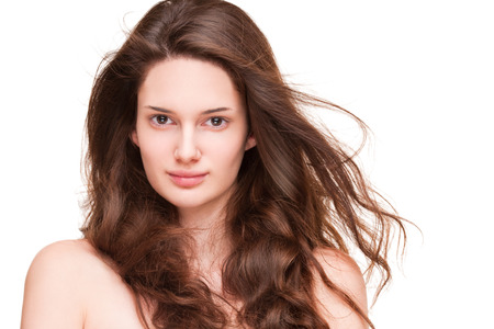 smooth hair: Portrait of a gorgeous young brunette woman with amazing full hair.