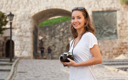 attractive gorgeous: Gorgeous young brunette woman using analog camera. Stock Photo