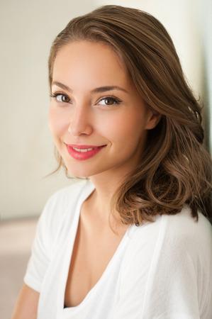 Close portrait of a tanned brunette summer beauty.
