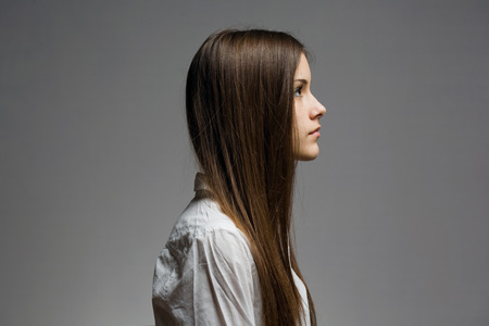 Expressive profile of young brunette.