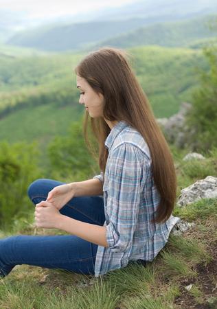 brunette woman: Cute young brunette woman enjoying beauty of nature.