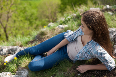 woman lying: Portrait of relaxed young brunette enjoying the view.