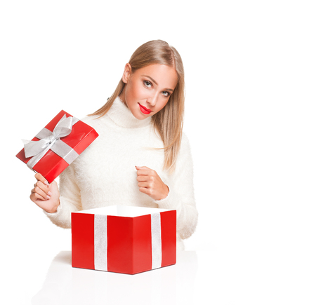 open box: Portrait of a beautiful blond christmas woman with gift box.