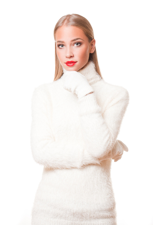 winter fashion: Portrait of a gorgeous young blond woman in winter fashion. Stock Photo