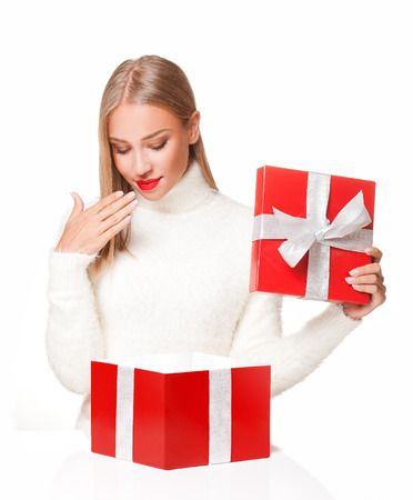 christmas present: Portrait of a beautiful blond christmas woman with gift box.