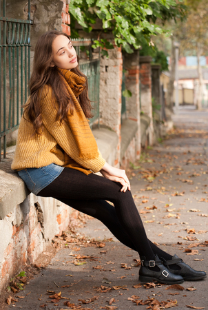 gorgeous girl: Outdoors portrait of a brunette autumn fashion beauty. Stock Photo
