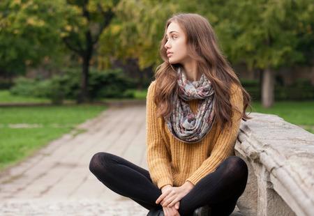 stockings woman: Outdoors portrait of a brunette autumn fashion beauty. Stock Photo
