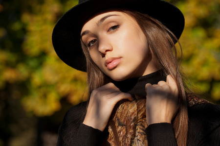 trend: Portrait of a young brunette beauty in autumn clothes.
