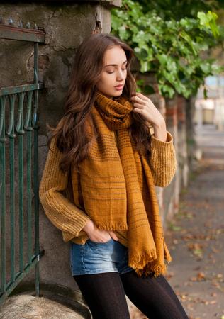 legging: Outdoors portrait of a brunette autumn fashion beauty. Stock Photo