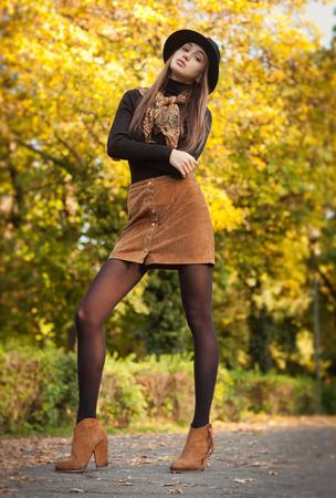 Outdoors portrait of a brunette autumn fashion beauty. Stock Photo