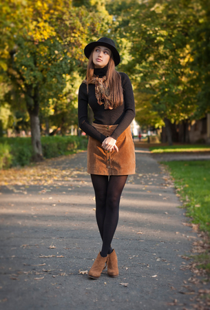 Outdoors portrait of a brunette autumn fashion beauty. Stock Photo