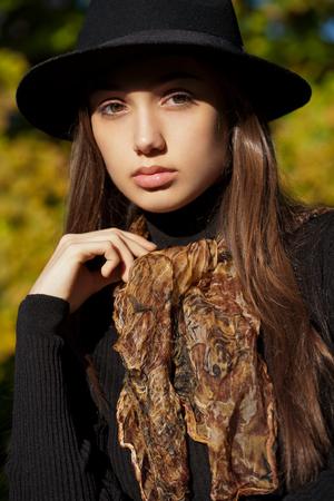 brunet: Outdoors portrait of a brunette autumn fashion beauty. Stock Photo