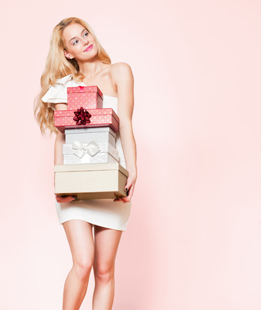 Portrait of a blond Christmas beauty holding gift boxes. Stock Photo