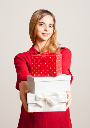 gift boxes: Portrait of a beautiful young woman with Christmas gift boxes.