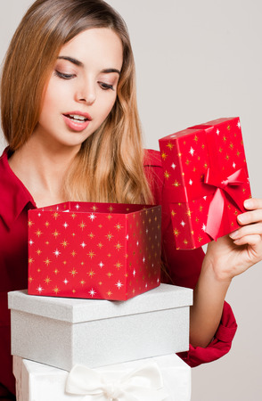 Portrait of a Christmas beauty holding gift boxes. photo