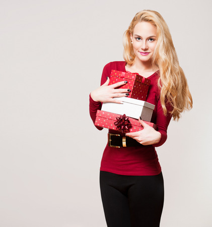 blonde woman: Portrait of a gorgeous young blond woman with Christmas gift boxes.